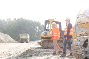 Supervisors walking at construction site against clear skyの写真素材 [FYI03656943]