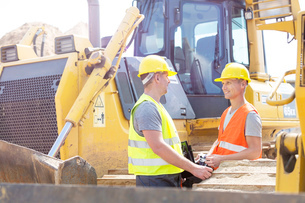 Engineers discussing at construction siteの写真素材 [FYI03657035]