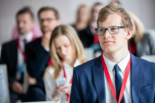 Businessman attending seminar in convention centerの写真素材 [FYI03657430]
