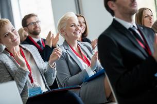 Happy business people applauding during seminarの写真素材 [FYI03657436]