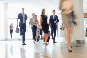 Blurred motion of business people walking at convention centerの写真素材 [FYI03657443]