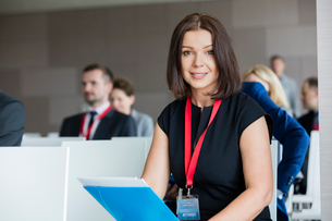 Portrait of confident businesswoman sitting in seminar hallの写真素材 [FYI03657466]