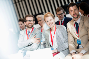 Portrait of happy business people sitting in seminar hallの写真素材 [FYI03657572]
