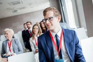 Businessman attending seminar in convention centerの写真素材 [FYI03657603]