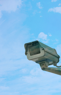 Security camera on wall against cloudsの写真素材 [FYI03657879]