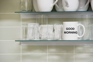 Cup on shelf with Good morning Textの写真素材 [FYI03657920]