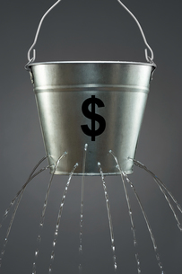Leaky Dollar Bucketの写真素材 [FYI03657934]