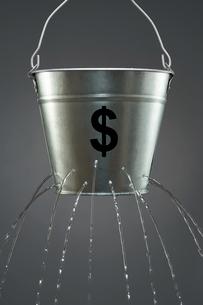 Leaky Dollar Bucketの写真素材 [FYI03657934]