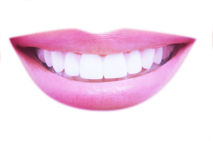 Closeup of beautiful smile with healthy teeth on white backgroundの写真素材 [FYI03657972]