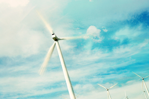 Wind Turbine against sky with clouds and sunの写真素材 [FYI03658026]