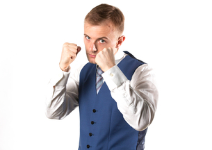 Businessman posing showing that he is a fighterの写真素材 [FYI03658144]