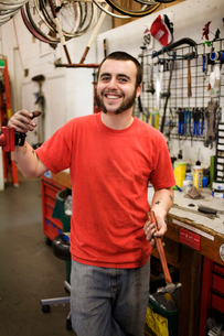 Portrait of bicycle repairmanの写真素材 [FYI03670519]