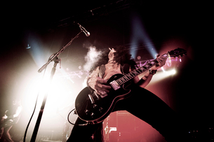 Rock Bassist performing on stageの写真素材 [FYI03670655]