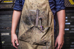 Dirty apron of printing house workerの写真素材 [FYI03678076]