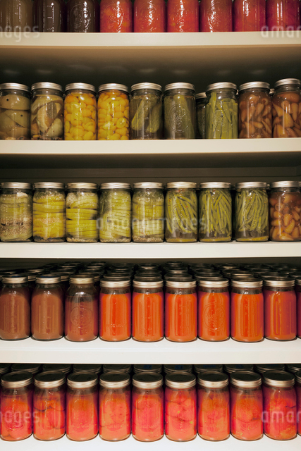 Jars with pickled food on shelvesの写真素材 [FYI03683537]