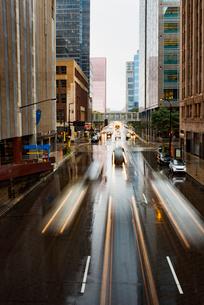 Long exposure of vehicles moving on city street during rainy seasonの写真素材 [FYI03683875]