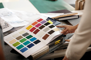 Cropped image of interior designer examining color swatches at officeの写真素材 [FYI03684196]