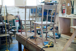Wooden chairs and work tools at industryの写真素材 [FYI03684665]