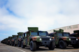 Military vehicles parked at industry against cloudy skyの写真素材 [FYI03685474]