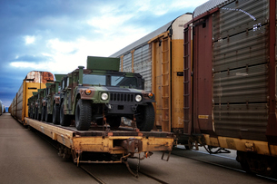 Military vehicles loaded on trainの写真素材 [FYI03685481]