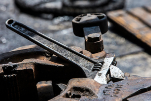 Close-up of wrench on machinery at industryの写真素材 [FYI03686110]