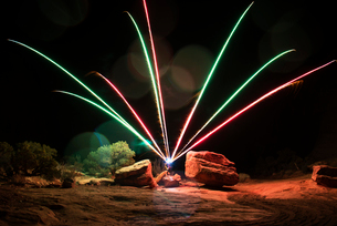 Display of fireworks over field at nightの写真素材 [FYI03689502]