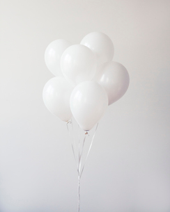 Bunch of balloons against wallの写真素材 [FYI03693537]