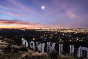 High angle view of Hollywood sign by illuminated city at duskの写真素材 [FYI03695589]