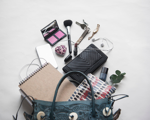 High angle view of personal accessories on white backgroundの写真素材 [FYI03695774]