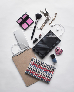 Overhead view of personal accessories on white backgroundの写真素材 [FYI03695776]