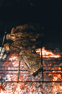 High angle view of steak on barbeque grillの写真素材 [FYI03696164]