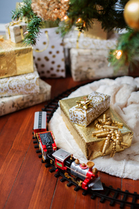 High angle view of miniature train and gift boxesの写真素材 [FYI03700162]