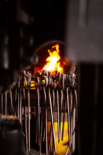 Various metallic tongs against fire in factoryの写真素材 [FYI03702752]