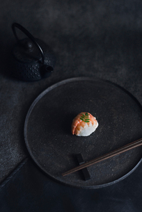High angle view of sushi with chopsticks in plateの写真素材 [FYI03702824]