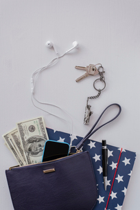 High angle view of US paper currency with various objects on white tableの写真素材 [FYI03705339]