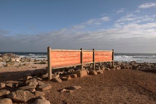 Information sign at beach against sky during sunny dayの写真素材 [FYI03707249]