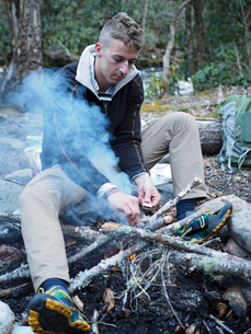 Hiker lighting up campfire at Pisgah National Forestの写真素材 [FYI03711721]