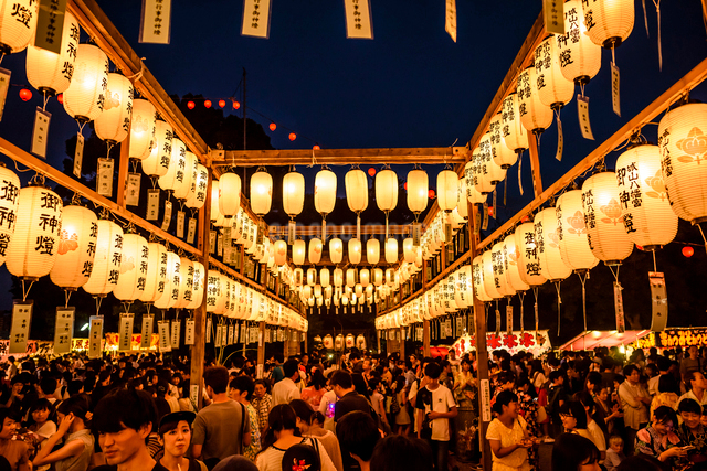 High angle view of large group of people at lantern festival during nightの写真素材 [FYI03716690]