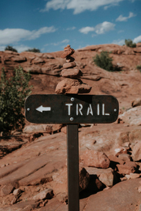 Directional sign at Arches National Park against skyの写真素材 [FYI03717804]