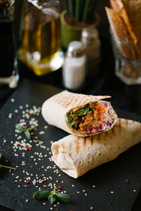 High angle view of wrap sandwich served on tableの写真素材 [FYI03718816]