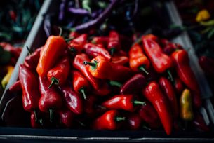 High angle view of red chili peppers in basket at market stallの写真素材 [FYI03727699]