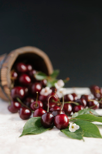 Close-up of cherries on table against gray backgroundの写真素材 [FYI03728412]