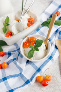 High angle view of ice cream with cherries on tableの写真素材 [FYI03728417]