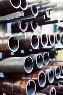 Close-up of metallic pipes hanging in industryの写真素材 [FYI03730430]