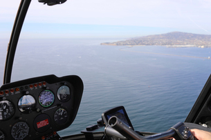 Scenic view of sea seen through helicopter's windshieldの写真素材 [FYI03732825]