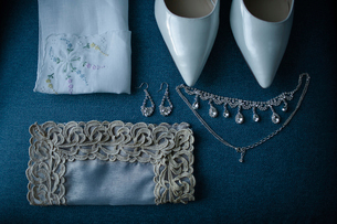 High angle view of personal accessories on table during wedding ceremonyの写真素材 [FYI03734375]