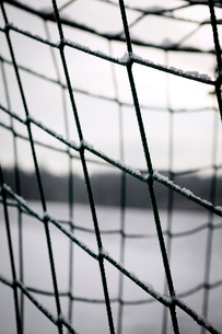 Close-up of snow on soccer netの写真素材 [FYI03735038]