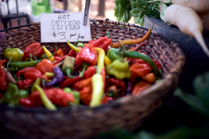 High angle view of chili peppers for sale in wicker basket at market stallの写真素材 [FYI03735787]