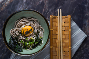 Close-up of noodle soup served with chopsticks on tableの写真素材 [FYI03736750]