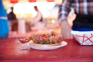Close-up of seafood served in plate on wooden tableの写真素材 [FYI03738479]